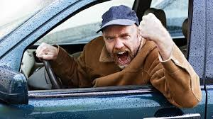 Man in car with road rage.